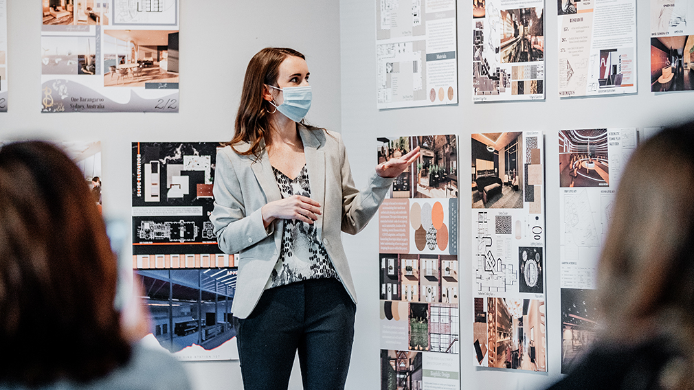 A student from the Anderson University School of Interior Design presents her work as a part of the school's annual senior showcase.