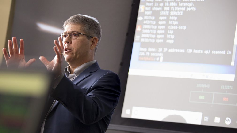 Dr. Kenneth Knapp, director of the Anderson University Center for Cybersecurity, teaches in front of a class.