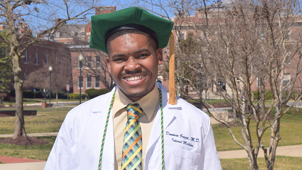 Donovan Griggs, a graduate of the Anderson University College of Arts and Sciences, dons his white coat as he prepares to enter an internship at the prestigious Massachusetts General Hospital.