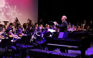 Orchestra performance with director leading